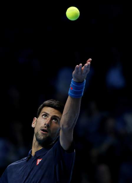 Novak Djokovic of Serbia serves to Andy Murray of Britain during their ATP World Tour Finals singles final tennis match at the O2 arena in London, Sunday, Nov. 20, 2016. (AP Photo/Alastair Grant)