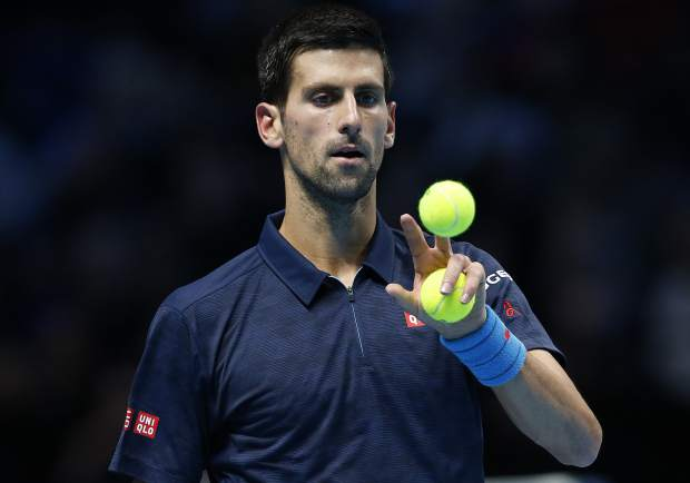 Novak Djokovic of Serbia plays with the balls during his ATP World Tour Finals singles final tennis match against Andy Murray of Britain at the O2 Arena in London, Sunday, Nov. 20, 2016. (AP Photo/Alastair Grant)