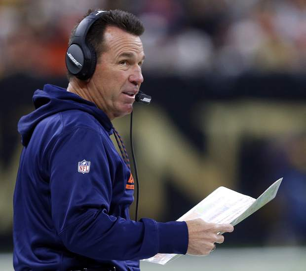 Denver Broncos head coach Gary Kubiak works the sideline in the first half of an NFL football game against the New Orleans Saints in New Orleans, Sunday, Nov. 13, 2016. (AP Photo/Butch Dill)