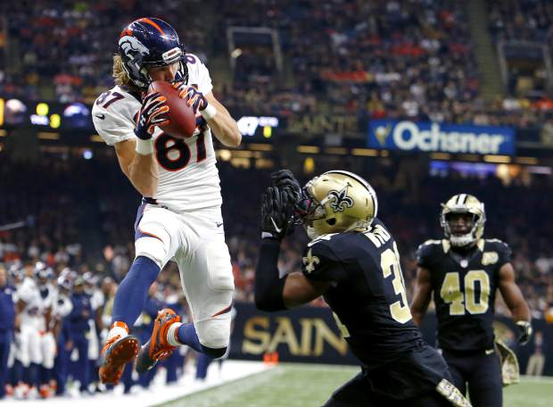 Denver Broncos wide receiver Jordan Taylor (87) pulls in a touchdown reception in front of New Orleans Saints free safety Jairus Byrd (31) in the first half of an NFL football game in New Orleans, Sunday, Nov. 13, 2016. (AP Photo/Butch Dill)