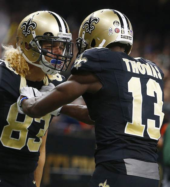 New Orleans Saints wide receiver Willie Snead (83) celebrates his touchdown reception with wide receiver Michael Thomas (13) in the second half of an NFL football game against the Denver Broncos in New Orleans, Sunday, Nov. 13, 2016. (AP Photo/Butch Dill)