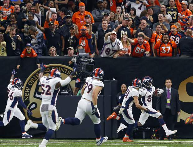 Denver Broncos defensive back Will Parks  celebrates in the end zone with teammates after returning a blocked extra point for a safety in the second half of an NFL football game against the New Orleans Saints in New Orleans, Sunday, Nov. 13, 2016. The Broncos won 25-23. (AP Photo/Butch Dill)