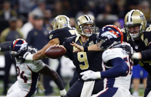 New Orleans Saints quarterback Drew Brees (9) passes under pressure in the first half of an NFL football game against the Denver Broncos in New Orleans, Sunday, Nov. 13, 2016. (AP Photo/Butch Dill)