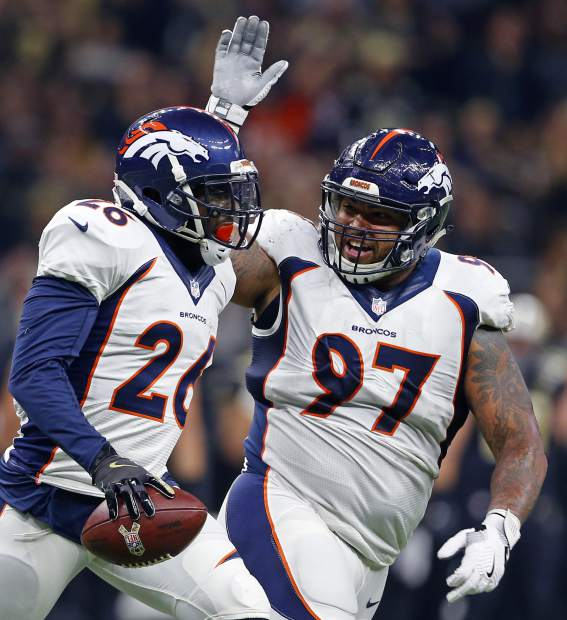 Denver Broncos free safety Darian Stewart (26) celebrates his interception with defensive tackle Billy Winn (97) in the first half of an NFL football game against the New Orleans Saints in New Orleans, Sunday, Nov. 13, 2016. (AP Photo/Butch Dill)