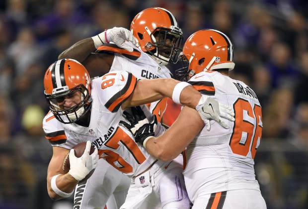 Cleveland Browns tight end Seth DeValve, left, celebrates his touchdown with teammates Isaiah Crowell, center, and Spencer Drango in the first half an NFL football game against the Baltimore Ravens, Thursday, Nov. 10, 2016, in Baltimore. (AP Photo/Nick Wass)