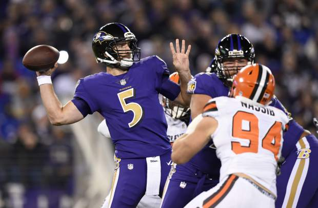 Baltimore Ravens quarterback Joe Flacco (5) throws to a receiver during the first half the team's NFL football game against the Cleveland Browns, Thursday, Nov. 10, 2016, in Baltimore. (AP Photo/Gail Burton)