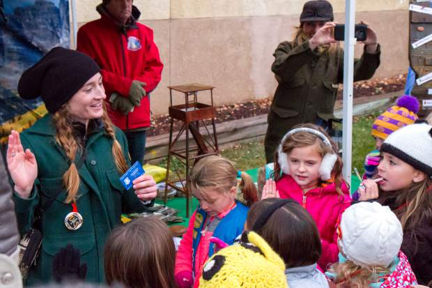 White River National Forest Public Affairs Officer Kate Jerman speaks to a group of kids during the U.S. Capitol Christmas tree event in Centennial Park.