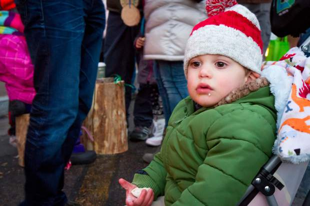 One year old Michael Frow enjoys a cookie by the firepit at the welcoming of the U.S. Capitol Christmas Tree in Centennial Park.