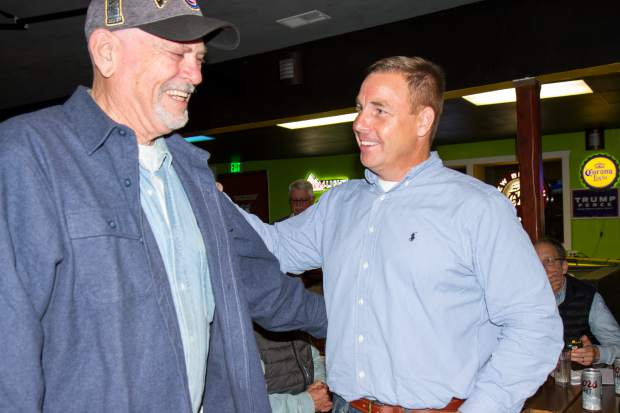 New 9th Judicial District Attorney Jeff Cheney speaks with a supporter during the watch party at K Seas Winghouse on Tuesday night.