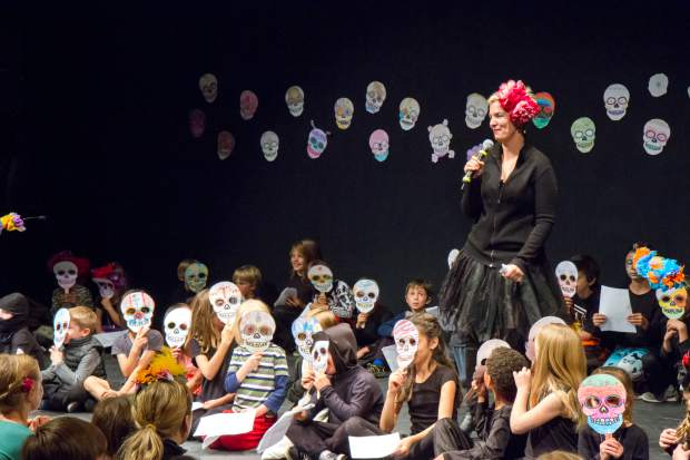 Members of the Ross Montessori School perform for a large crowd as part of the Dia De Los Muertos festival at the Thunder River Theater on Friday evening.