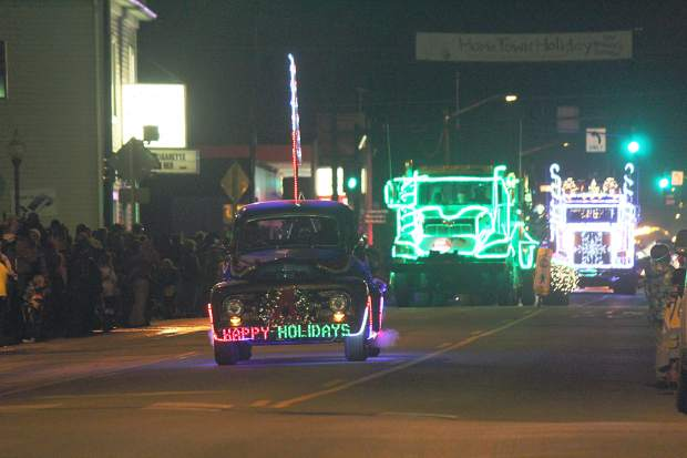 The Elder Construction, Inc., team makes their way down Railroad Avenue in the 2015 Hometown Holiday Celebration Parade of Lights.