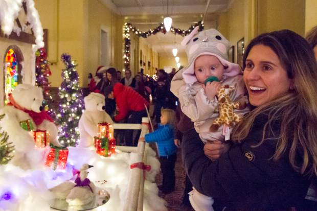 Maya Lerch and 6 month old Laura looks at the polar bears and lights at the 27th annual Festival of Lights at the Hotel Colorado.