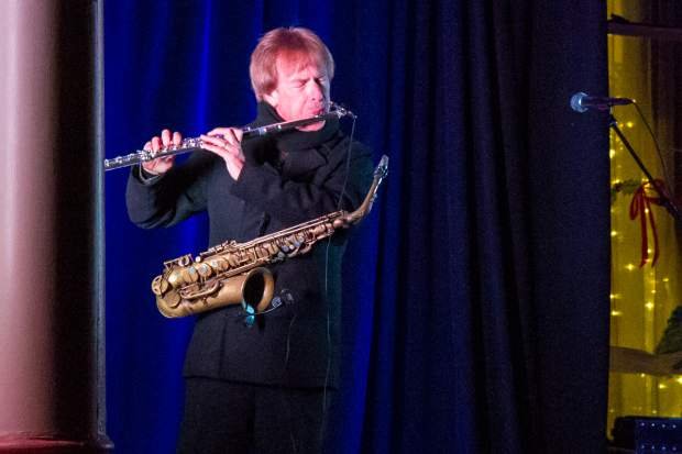 Bryan Savage performs for the crowd during the 27th annual Festival of Lights at the Hotel Colorado.