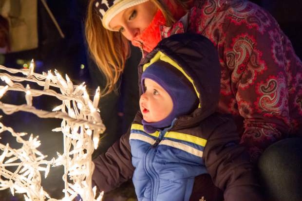 One-year-old Declan Vanteylingen looks at the lights at the 27th annual Festival of Lights at the Hotel Colorado. The festival included multiple performances, music by Syphony in the Valley, John Chandler, Bryan Savage and local vocalists Kelly Ehlers and Melissa Hefferon. Santa made a special appearance before the lighting ceremony and fireworks show in the courtyard.