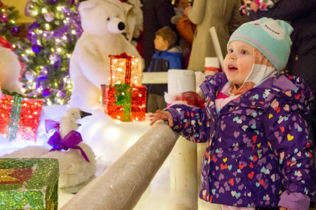 Two-year-old Emmaline Watkins traveled from Ft. Collins with her family to enjoy the 27th annual Festival of Lights at the Hotel Colorado. The festival included multiple performances, music by Syphony in the Valley, John Chandler, Bryan Savage and local vocalists Kelly Ehlers and Melissa Hefferon. Santa made a special appearance before the lighting ceremony and fireworks show in the courtyard. For more photos and a video of the fireworks go to postindependent.com
