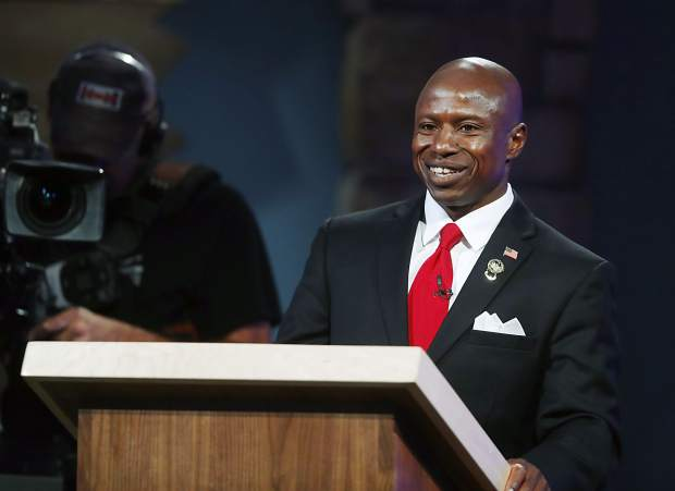 Republican U.S. Seante candidate Darryl Glenn laughs during his debate with U.S. Sen. Michael Bennet, D-Colo., at History Colorado late Tuesday, Oct. 11, 2016, in Denver. (AP Photo/David Zalubowski)