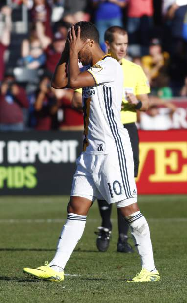 Los Angeles Galaxy forward Giovani dos Santos reacts after his kick was stopped by Colorado Rapids goalkeeper Tim Howard in the second-leg soccer match of the Western Conference semifinals of the MLS cup playoffs in Commerce City, Colo., Sunday, Nov. 6, 2016. (AP Photo/David Zalubowski)