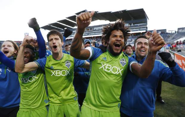 From left to right, Seattle Sounders midfielders Erik Friberg, Oniel Fisher and Alvaro Fernandez, defender Roman Torres and forward Herculez Gomez celebrate after defeating the Colorado Rapids in the second leg of the MLS Western Conference soccer finals Sunday, Nov. 27, 2016, in Commerce City, Colo. (AP Photo/David Zalubowski)