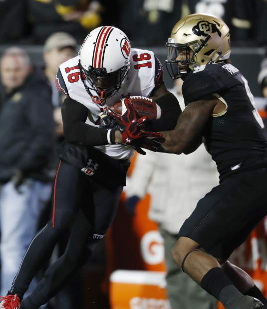 Utah wide receiver Cory Butler-Byrd, left, is tackled after a long gain by Colorado defensive back Tedric Thompson in the second half of an NCAA college football game Saturday, Nov. 26, 2016, in Boulder, Colo. Colorado won 27-22. (AP Photo/David Zalubowski)