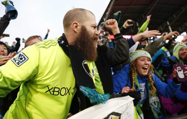Seattle Sounders fans celebrates after the team defeated the Colorado Rapids in the second leg of the MLS Western Conference soccer finals Sunday, Nov. 27, 2016, in Commerce City, Colo. (AP Photo/David Zalubowski)