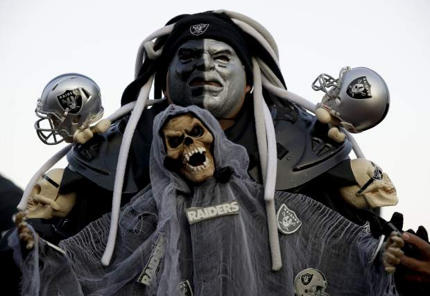 Oakland Raiders fans arrive at Azteca Stadium before an NFL football game against the Houston Texans Monday, Nov. 21, 2016, in Mexico City. (AP Photo/Rebecca Blackwell)