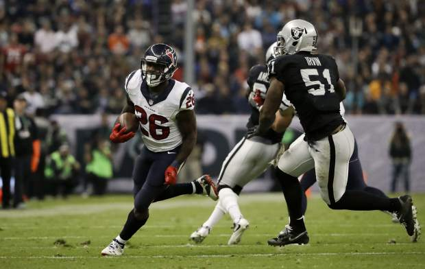 Houston Texans running back Lamar Miller runs upfield during the first half of an NFL football game against the Oakland Raiders Monday, Nov. 21, 2016, in Mexico City. (AP Photo/Rebecca Blackwell)