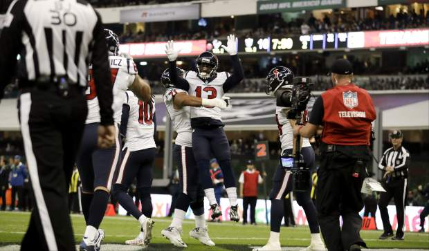 Houston Texans wide receiver Braxton Miller is lifted by teammate guard Xavier Su'a-Filo after scoring a touchdown during the first half of an NFL football game against the Oakland Raiders Monday, Nov. 21, 2016, in Mexico City. (AP Photo/Rebecca Blackwell)