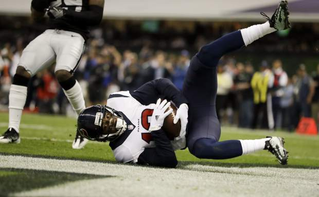 Houston Texans wide receiver Braxton Miller scores a touchdown during the first half of an NFL football game against the Oakland Raiders Monday, Nov. 21, 2016, in Mexico City. (AP Photo/Rebecca Blackwell)
