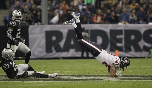 Houston Texans tight end C.J. Fiedorowicz makes a catch during the first half of an NFL football game against the Oakland Raiders Monday, Nov. 21, 2016, in Mexico City. (AP Photo/Rebecca Blackwell)