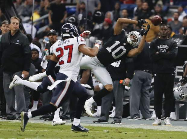 Oakland Raiders wide receiver Seth Roberts (10) can't hold on to a pass as Houston Texans strong safety Quintin Demps defends during the first half of an NFL football game Monday, Nov. 21, 2016, in Mexico City. (AP Photo/Eduardo Verdugo)