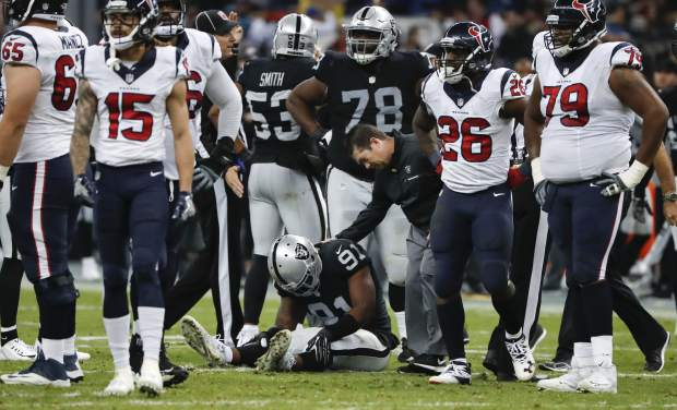 Oakland Raiders linebacker Shilique Calhoun stays down after an injury during the first half of an NFL football game against the Houston Texans Monday, Nov. 21, 2016, in Mexico City. (AP Photo/Eduardo Verdugo)