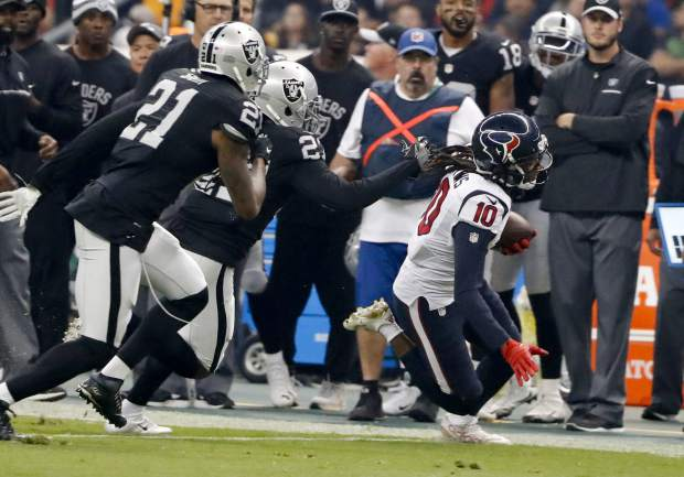 Houston Texans wide receiver DeAndre Hopkins (10) steps out of bounds as he runs during the first half of an NFL football game against the Oakland Raiders Monday, Nov. 21, 2016, in Mexico City. (AP Photo/Eduardo Verdugo)