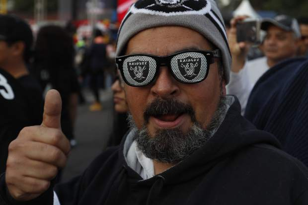 Oakland Raiders fans take pictures in front of Azteca Stadium before an NFL football game against the Houston Texans Monday, Nov. 21, 2016, in Mexico City. (AP Photo/Eduardo Verdugo)