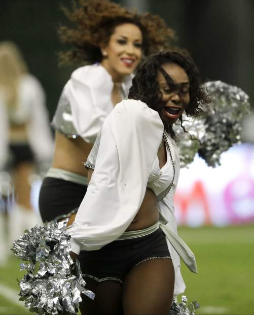 Oakland Raiders cheerleaders perform during the first half of an NFL football game against the Houston Texans Monday, Nov. 21, 2016, in Mexico City. (AP Photo/Rebecca Blackwell)