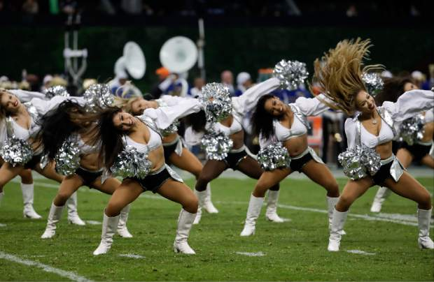 Oakland Raiders cheerleaders perform during the halftime celebration of an NFL football game between the Houston Texans and the Oakland Raiders Monday, Nov. 21, 2016, in Mexico City. (AP Photo/Rebecca Blackwell)