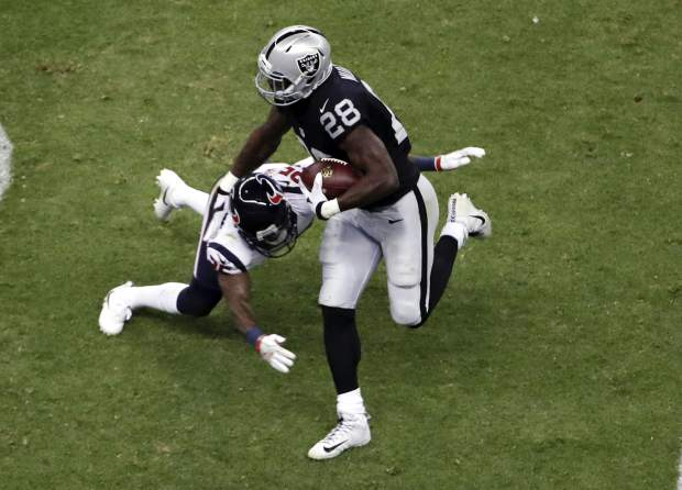 Oakland Raiders running back Latavius Murray gets past Houston Texans cornerback Kareem Jackson during the second half of an NFL football game Monday, Nov. 21, 2016, in Mexico City. (AP Photo/Dario Lopez-Mills)