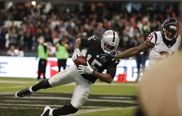 Oakland Raiders wide receiver Michael Crabtree drops an end zone pass in front of Houston Texans cornerback A.J. Bouye during the second half of an NFL football game Monday, Nov. 21, 2016, in Mexico City. (AP Photo/Eduardo Verdugo)