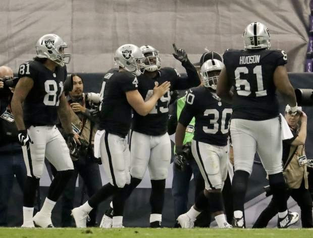 Houston Texans outside linebacker Tony Washington points skyward after as he celebrates with teammates after scoring a touchdown during the second half of an NFL football game against the Houston Texans Monday, Nov. 21, 2016, in Mexico City. (AP Photo/Rebecca Blackwell)