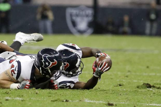 Houston Texans running back Akeem Hunt reaches with the ball but does not get the first down during the second half of an NFL football game against the Oakland Raiders Monday, Nov. 21, 2016, in Mexico City. (AP Photo/Rebecca Blackwell)