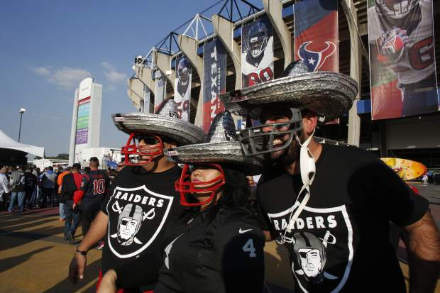 Oakland Raiders fans look at Azteca Stadium before an NFL football game against the Houston Texans Monday, Nov. 21, 2016, in Mexico City. (AP Photo/Dario Lopez-Mills)