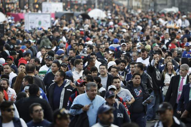 Fans wait to enter Azteca Stadium before an NFL football game between the Houston Texans and the Oakland Raiders Monday, Nov. 21, 2016, in Mexico City. (AP Photo/Eduardo Verdugo)