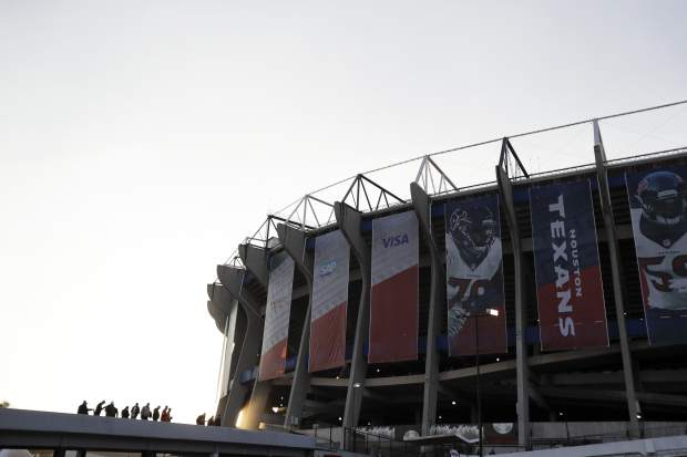 Fans arrive to Azteca Stadium before an NFL football game between the Houston Texans and the Oakland Raiders Monday, Nov. 21, 2016, in Mexico City. (AP Photo/Rebecca Blackwell)