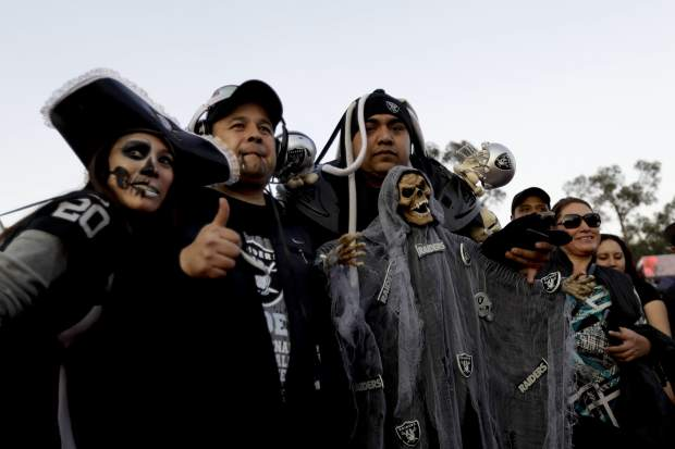 Fans arrive at Azteca Stadium before an NFL football game between the Houston Texans and the Oakland Raiders Monday, Nov. 21, 2016, in Mexico City. (AP Photo/Rebecca Blackwell)
