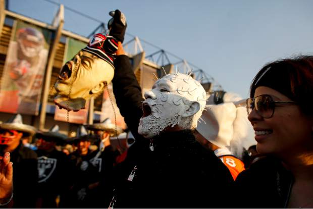 Oakland Raiders fans arrive at Azteca Stadium before an NFL football game against the Houston Texans Monday, Nov. 21, 2016, in Mexico City. (AP Photo/Dario Lopez-Mills)