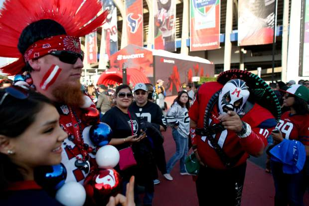 Fans for the Houston Texans and the Oakland Raiders arrive at Azteca Stadium before an NFL football game Monday, Nov. 21, 2016, in Mexico City. (AP Photo/Dario Lopez-Mills)