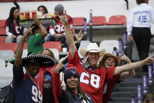 Houston Texans fans cheer before an NFL football game against the Oakland Raiders Monday, Nov. 21, 2016, in Mexico City. (AP Photo/Rebecca Blackwell)