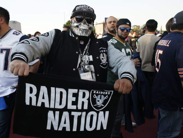 A Oakland Raiders fan arrives at Azteca Stadium before an NFL football game against the Houston Texans Monday, Nov. 21, 2016, in Mexico City. (AP Photo/Dario Lopez-Mills)