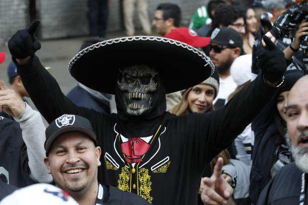 Oakland Raiders fans arrive to Azteca Stadium before an NFL football game against  the Houston Texans Monday, Nov. 21, 2016, in Mexico City. (AP Photo/Rebecca Blackwell)