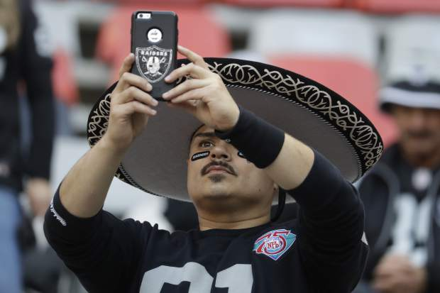 A Oakland Raiders fan looks on before an NFL football game against the Houston Texans Monday, Nov. 21, 2016, in Mexico City. (AP Photo/Rebecca Blackwell)