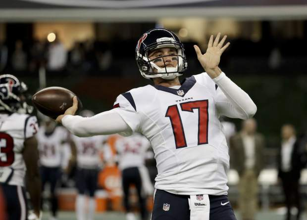 Houston Texans quarterback Brock Osweiler warms up before an NFL football game against the Oakland Raiders Monday, Nov. 21, 2016, in Mexico City. (AP Photo/Rebecca Blackwell)
